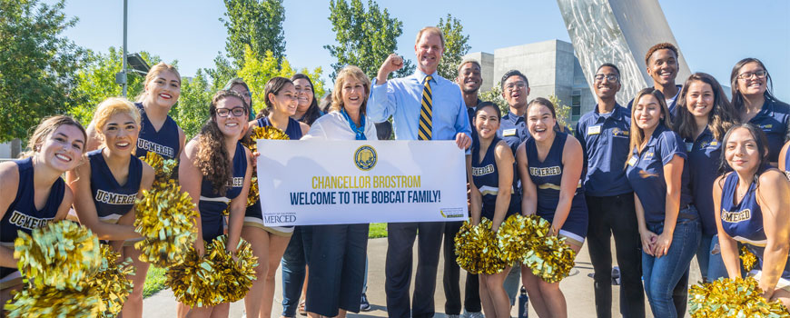 Chancellor Brostrom, wife and UC Merced Cheerleaders welcoming our first-year students during the Scholar's Lane Journey.