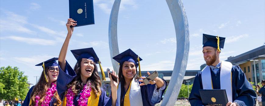 UC Merced graduates celebrating commencement.