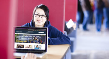 UC Merced student reviewing Summer Session website