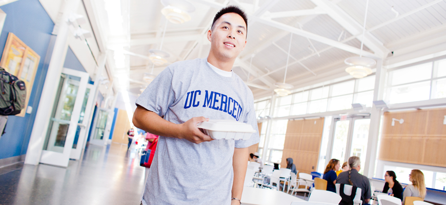 UC Merced student in dining hall