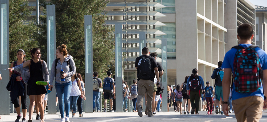 UC Merced students walking down Scholar Lane.