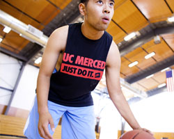 Summer Session student plays basketball at the Gallo Recreation Center