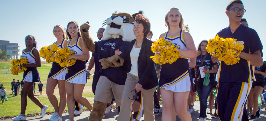 UC Merced - Chancellor Leland and Rufus Bobcat walk students across campus