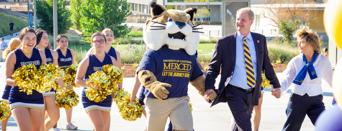 UC Merced - Chancellor Nathan Brostrom and Rufus Bobcat walk students across campus